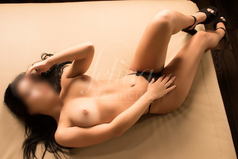 Molly: High end Colombian escort for MFF in Valencia for orgy, draped on bed